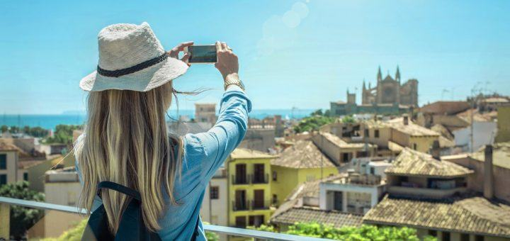 Tourist is taking pictures in Palma de Mallorca